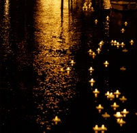 School children float candles on the Limmat River and eat gingerbread and drink hot punch to celebrate Christmas in Zurich, Switzerland, .