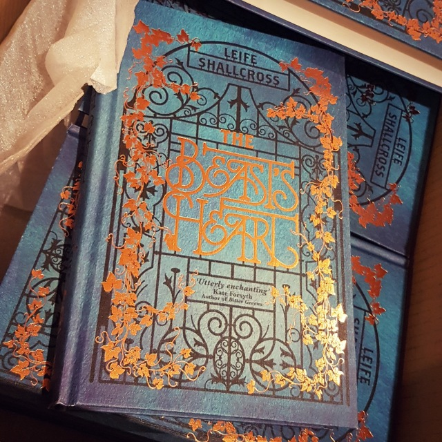A box full of hard cover books, titled The Beast's Heart.